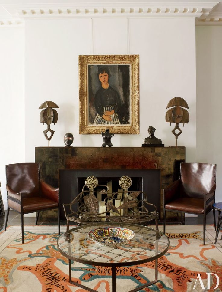 Leather Jean-Michel Frank chairs flank the mica mantel in a London sitting room by Jacques Grange.