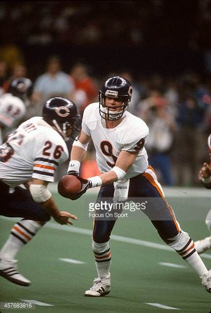Jim McMahon of the Chicago Bears hands the ball off to Matt Suhey against New England Patriots during Super Bowl XX January 26 1986 at the Louisiana...
