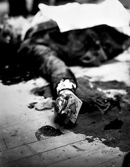 SHOT A 1931 image of the dead mobster Joe Masseria with the ace of spades in his hand. But the card may have been planted.