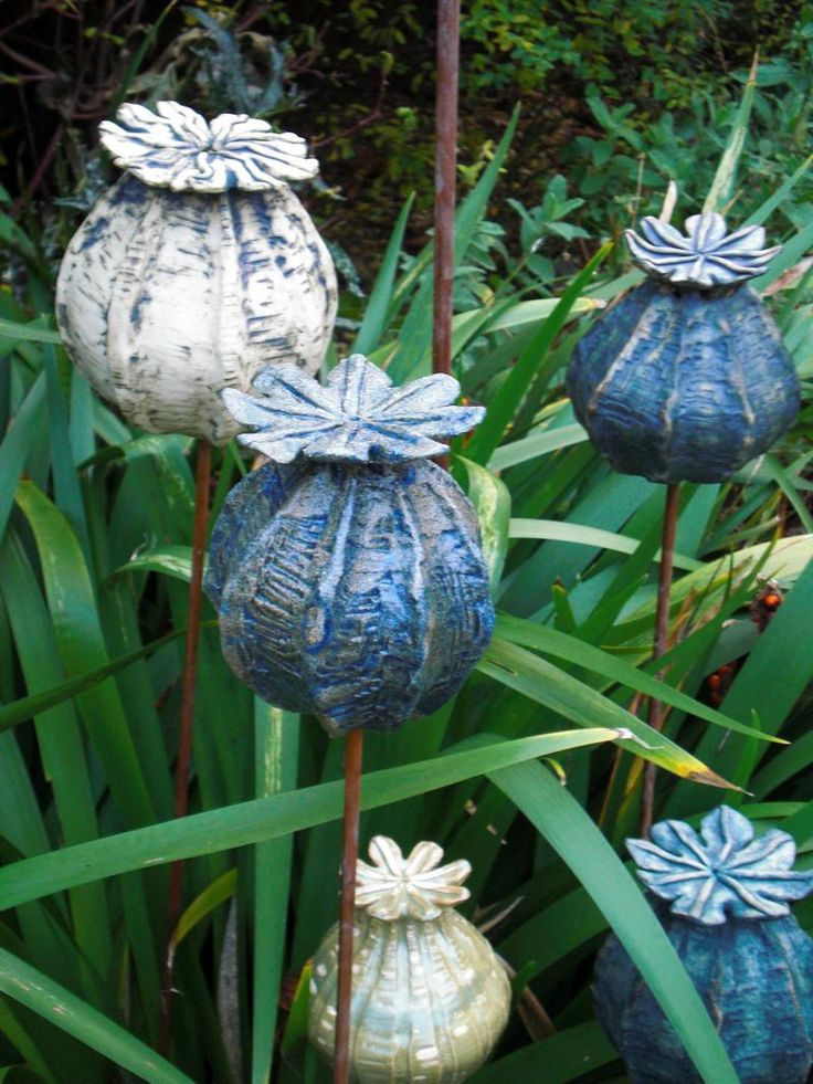 Make large - frog house and bird bath. Poppy seedheads, stoneware ceramics, handbuilt.