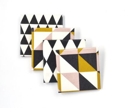Delightful retro-modern geometric pattern of this set of handmade ceramic tile coasters is simple yet stylish. Triangles and harlequin pattern in black and white with some pastel pink and mustard yellow.  They are heat and water resistant, and can be washed easily with a wet sponge. Self adhesive protective pads are added to the back to protect the furniture.