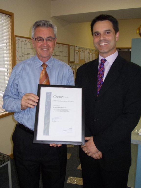 Stuart Burgess, Managing Director of IIPNZ presenting the Silver Accreditation certificate to Bernard Fitzgibbon, Principal of St John's School Mairangi Bay!