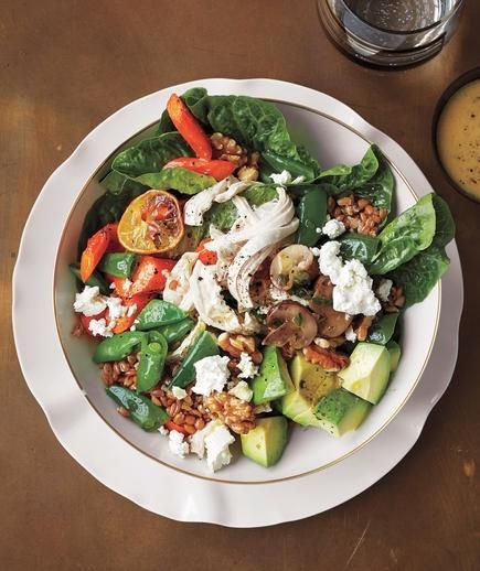 Chicken Health Bowl: Shredded chicken, farro, lemony carrots, marinated mushrooms, romaine, snap peas, avocado, Feta, walnuts, mustard vinaigrette