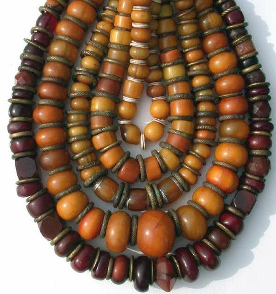 Amber coloured beads, masses of them...