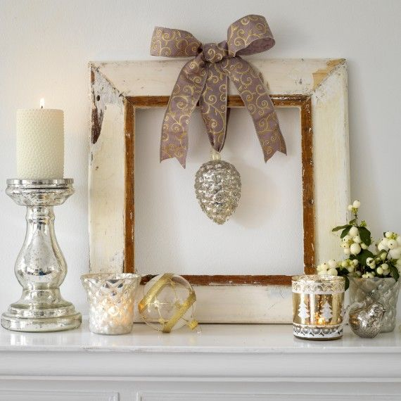 In the frame  Create a mantlepiece tableau with a rustic frame and a favourite bauble hung from ribbon.