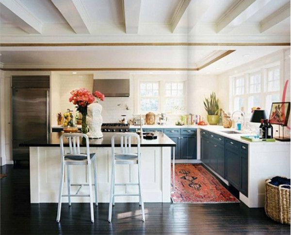 12 Kitchens & Dining Rooms Made Cozy With Kilims: David Cafiero of Cafiero Select designed this kitchen, seen in Lonny. The blue/gray fronts of the cabinetry warm up the basic white forms, as does the Persian runner and wicker baskets.