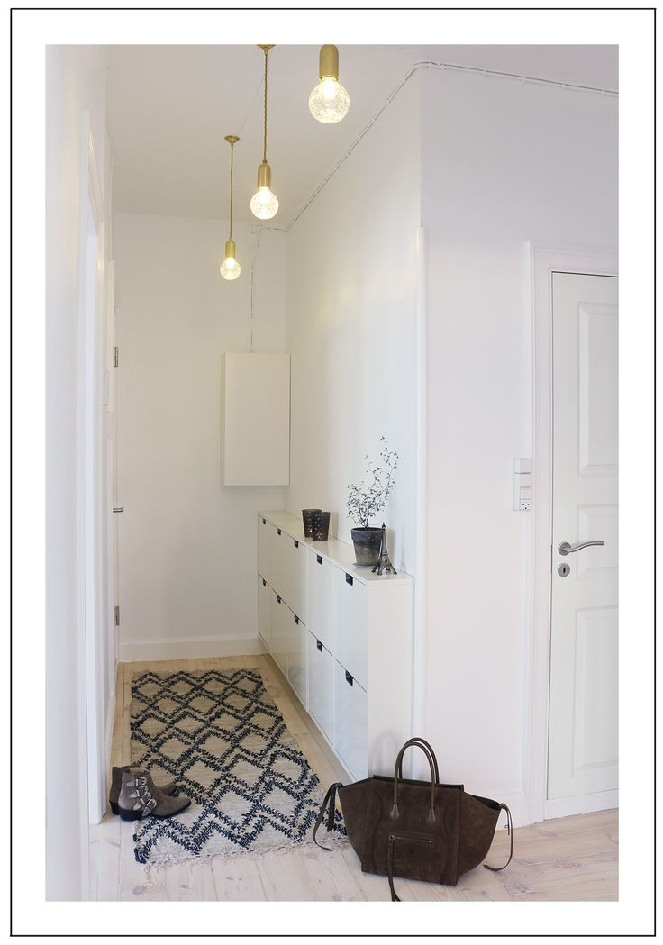 two ikea shoe storage in narrow hallway