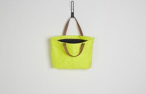 Sustainability - Lost Property of London are a company who recycle salvaged fabrics to create new products. This yellow bag is made out of an old sail, they upcycle into great designs and have a great ethic of the whole business. They have started to sell in high end shops, which encourages people to think about buying with thinking where the materials come from.