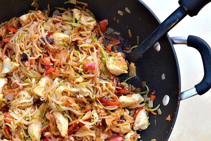 Szechuan Chicken with rice noodles - uses broccoli slaw - my favorite stir-fry shortcut. Might be able to reduce the oil in this recipe.