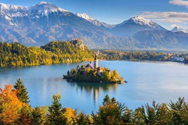 Lake Bled Sloveniathe Emerald Colored Lake Is Surrounded By Julian Alps With A Church On An Island And A Medieval Castl Lake Bled Lake Bled Slovenia Day Tours