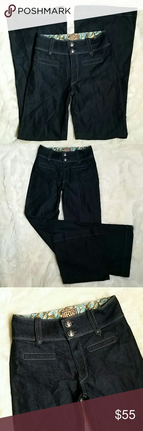 "Rich & Skinny High Waisted Wide Leg Trouser Sz 27 Rich & Skinny High Waisted Wide Leg Trouser Jeans, size 27. Dark blue clear rinse. Faux slit pockets on the front and back. Double button and zip fly. Pre-owned in great condition with no rips, holes, tears or stains...looks like new! Long original 35"" inseam and clean hems. 70% cotton and 30% PES (polyester) just a hint of stretch. Size 27.  Measurements  Waist 14.5"" Rise 10"" (High Waisted) Inseam 35"" Leg opening 12.5"" Rich & Skinny Jeans…"