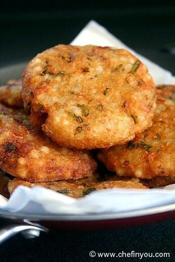 """Sago Fritters Recipe - If you thought Fasting was deprivation and eating boring food, then you would be surprised at how we Indians do ours in style :). We celebrate our deities, festivals, prayers and abstinence with happiness and joy. Guess these Sabudana Vadas (Sago fritters) made from Sago pearls, Potatoes and peanuts during Navaratri/Dussehra vrats (fasting) will prove that fact to you."""