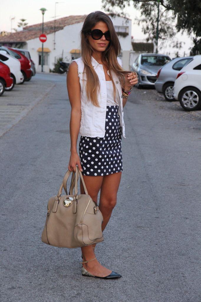 White jean sleeveless jacket, polkadot skirt, ankle strap flats