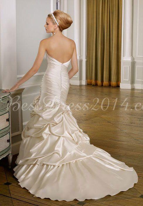 White wedding dress with red flower pick ups