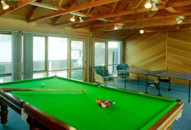 Whitecrest Resort facilities include a solar heated swimming pool, tennis court, basketball practice hoop and a recreation room with both billiards and table tennis facilities.