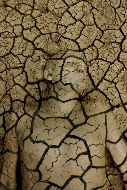 """""""Breaking Soil"""". (Photo by Johannes Stötter) http://avaxnews.net/wow/Impressive_Bodypainting_by_Johannes_Stotter.html"""