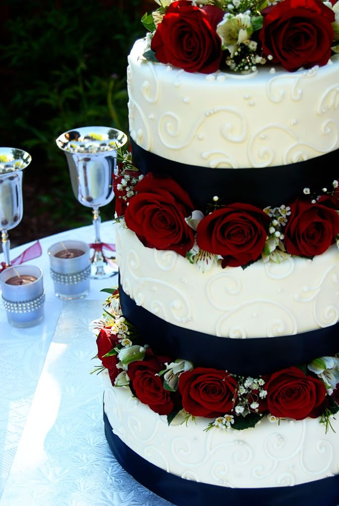 Black and white with red roses. This would be a wedding cake I'd choose for myself.