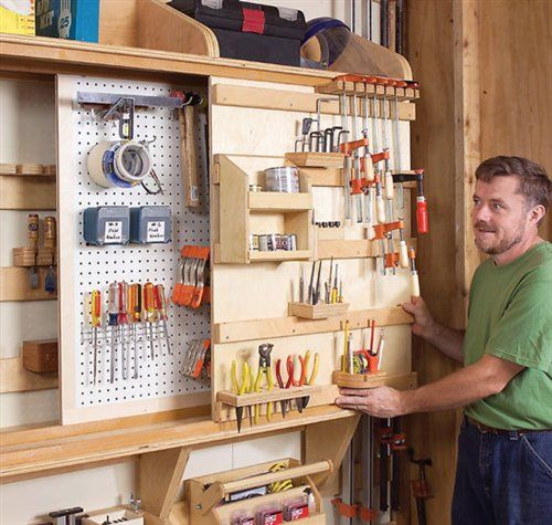Sliding panels for tool or craft storage. I love this idea because I have limited wall space & this essentially triples your storage. Of course, I would dress it up a bit for inside the house.