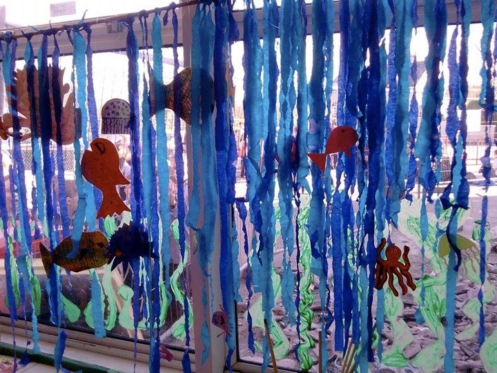 An art project I did with my daughters class - bamboo strung from the ceiling with light and dark streamers for water, laminated fish and sea life strung from fishing line and seaweed painted onto the window. They loved it. Got the idea off pinterest but can't find the original link to give credit! <3