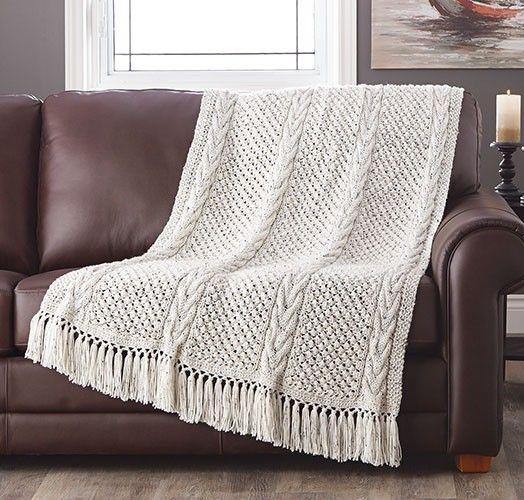 Our 2nd place winner! Designed by Emily Armstrong. Panels of horseshoe cables and trinity stitches will bring good luck to any home. Knit aran afghan.
