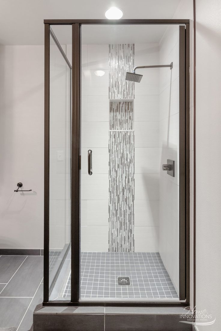 Custom Home Builder | Tulsa OK - Bathroom with enclosed shower featuring  vertical stripe glass tile