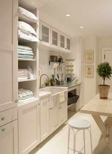 I would love this room!  Utility sink, laundry room, sewing and folding center...ahhhhh