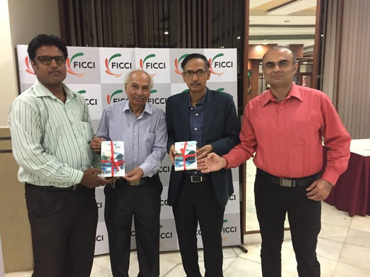 Author Bansi Dhameja presenting a copy of his book to Dr Pooran Chandra Pandey, Executive Director, United Nations Global Compact Network India