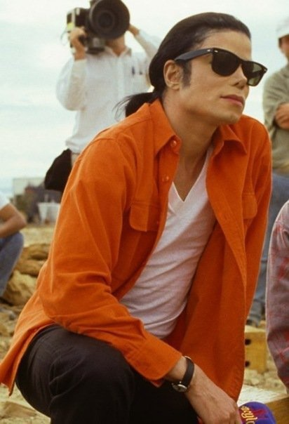 """.Michael Jackson behind the scenes of the """"In the Closet"""" video attire: Orange long sleeve open shirt, white t shirt and black slacks. Includes black shades"""
