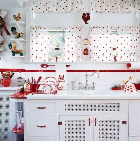 1940's Red & White Kitchen. Vented cabinet doors are right out of the postwar period.