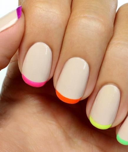 For the bride who loves a splash of color but doesn't want her nails to be the center of attention, try this twist on the traditional French manicure. A swipe of color on the top of the nail adds a subtle pop.