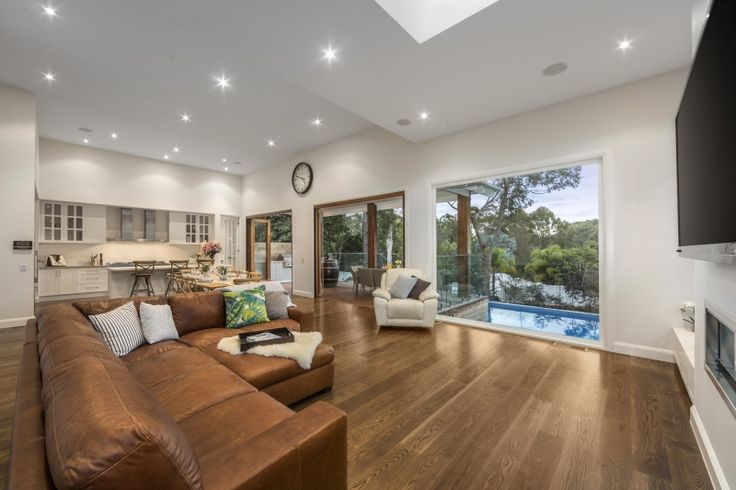 This open plan Kitchen, Living room and Dining room shows you just how much can be achieved when building on a Sloping block. This breathtaking panoramic tree lined view is truly one of a kind.