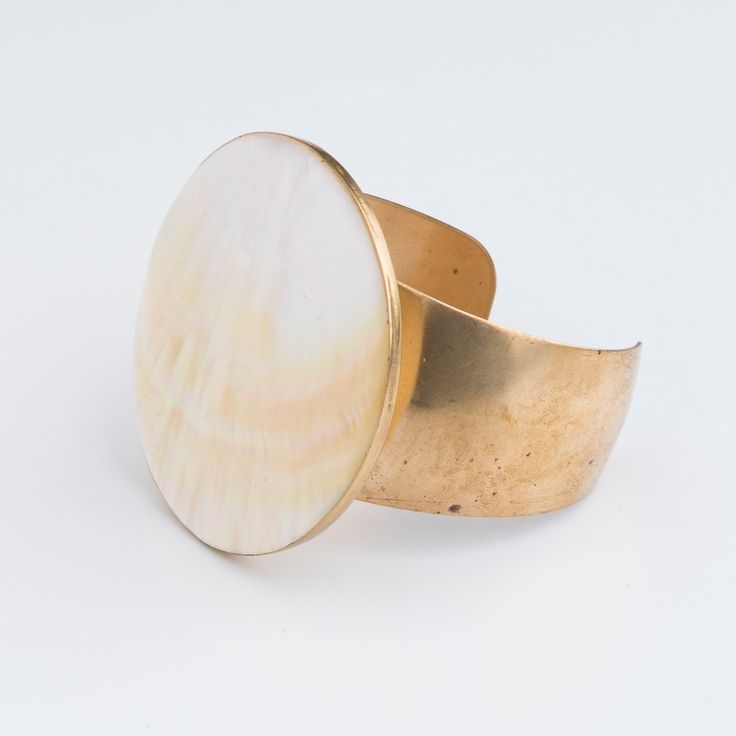 Moon Dancer Cuff : We took a perfect vintage mother of pearl disc and mounted on vintage cuff. So simple, so chic, so sustainable, so goes with everything, so perfect. Available in a very limited edition now on in our Etsy shop or www.ghostandlola.com