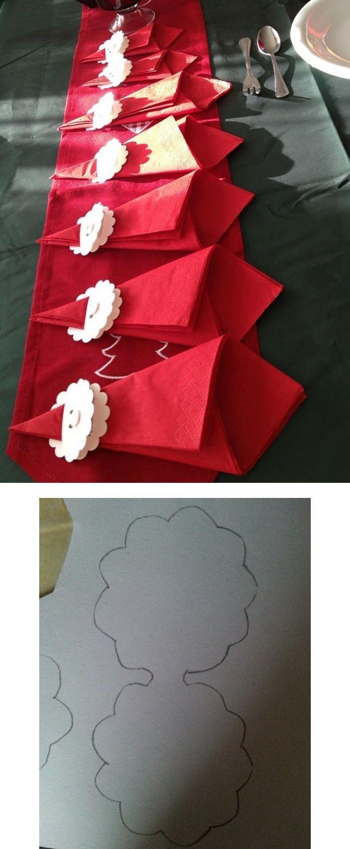 """Serviette """"Père Noël"""" marque-place. Le découpage est plié puis on fait une fente sur le haut pour pouvoir glisser la tête dans la serviette. La première partie sert à dessiner la tête et celle du dessous à marquer le prénom."""