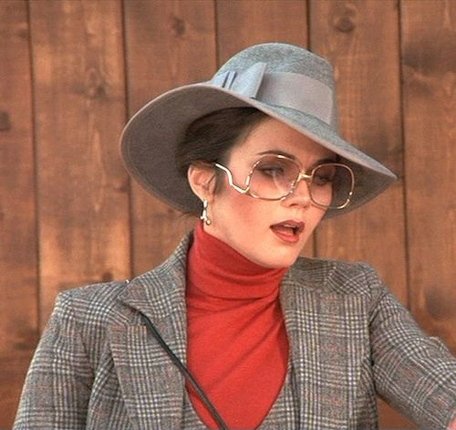 Lynda Carter wearing drop temple glasses