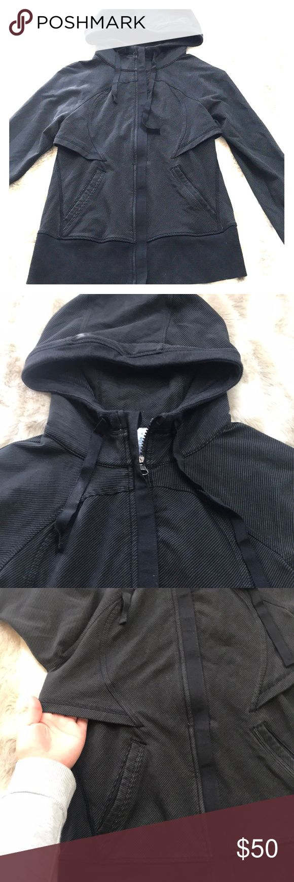 Lululemon Black Zip Up Hoodie 4 Not sure of the name for this, micro stripped black and gray with solid black trim. Two front pockets, thumb holes, under arm and back venting. Its cotton and spandex and medium wt single layer fabric. Not at thick as a scuba hoodie but a nice track jacket. Mild signs of wear. Ive worn and washed this once, I am the second owner. See pics for details. My lights wash out the color a bit it's more rich in person. lululemon athletica Jackets & Coats