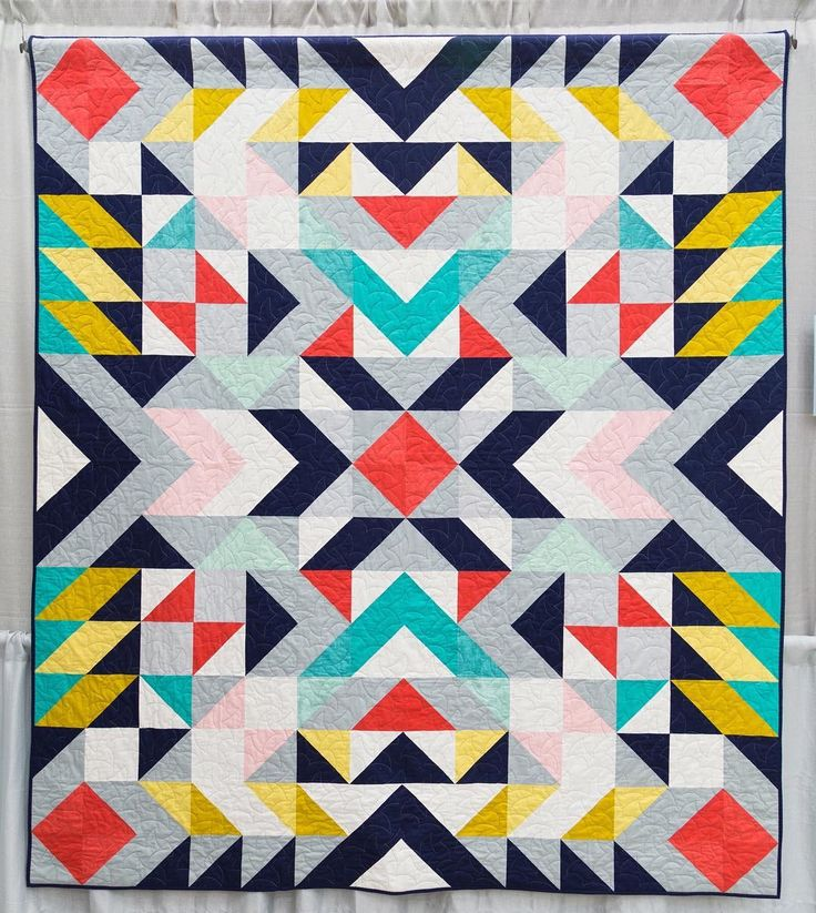 Happy Tuesday! This eye-catching quilt is Mercury by @migademiga from #quiltcon 2015. She says My inspiration for the design of this quilt was Navajo rugs and the bold use of geometric patterns. My goal was to design a high impact quilt design using mostly half square triangles. The colour palette I chose emerged organically as I played with shapes and colours. I used Illustrator to design this quilt which enabled me to really play around with different color palettes until I found one that…