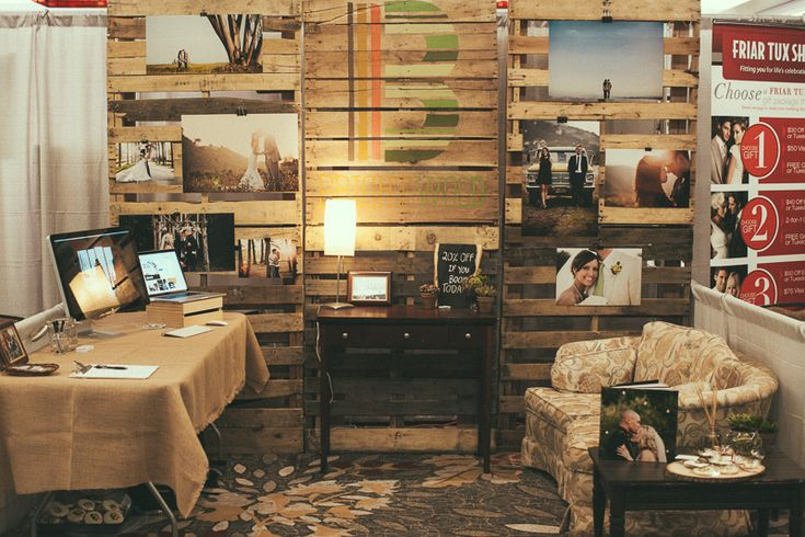 """We're looking at having a """"pallet wall,"""" and this bridal show booth looks cool!"""