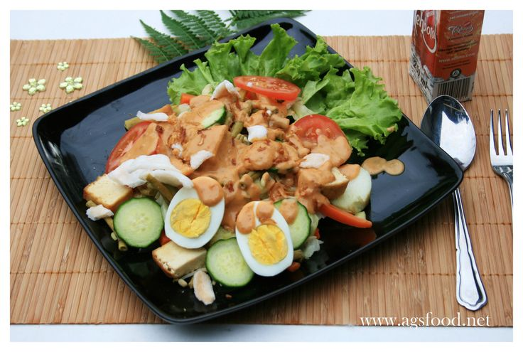 Gado-Gado. Indonesian salad! This yummy and healthy food comes from West Java, Indonesia. It was mixed boiled vegetables such as bean sprouts, cucumber, kangkung, tofu, tempe, squash, etc with a spicy peanut sauce dressing on top of it. You may mix another vegetable you like for sure!