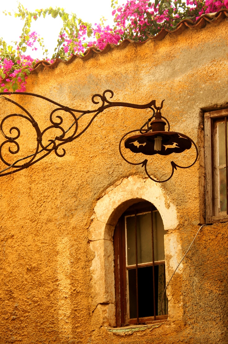 Lose Yourself in the small Alleys of Chania picturesque Town!  Head up ... interesting details everywhere ... Street Light!  www.cretetravel.com  #Chania #Town #Crete #Travel #Holidays #Art #Details