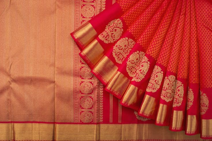 Love the red colour of this saree. The elephant motifs above the border add just that little bit extra to an otherwise traditional design.