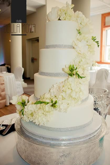 Elegant White Buttercream Wedding Cake With Bling Ribbon And Fresh Flowers.  #An Eclectic Stem