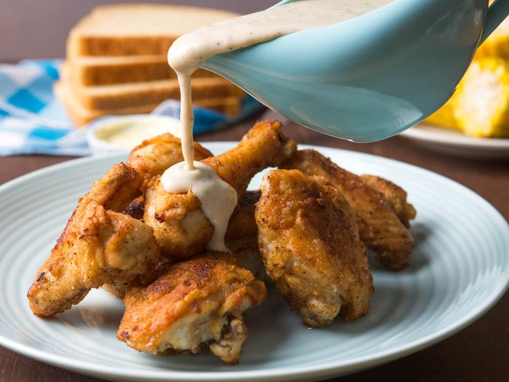 Ever wonder why there isn't a chicken-fried chicken alternative to chicken-fried steak? Turns out it exists, and it's called Maryland fried chicken. Shallow fried with a simple dredging of seasoned flour until golden, then topped with a white gravy made in the skillet after frying, this is a version of fried chicken you need to know about. #recipe #comfortfood #friedchicken