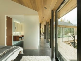 A narrow hallway leads from living area to the bedroom