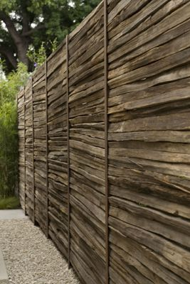 wooden privacy fence (repurposed split rail fencing?), in a Brentwood, Los Angeles garden designed by Artecho Architecture + Landscape Architecture