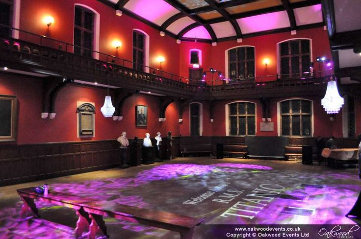 Ambient lighting, monogram and chandeliers for a themed ball at the Oxford Union