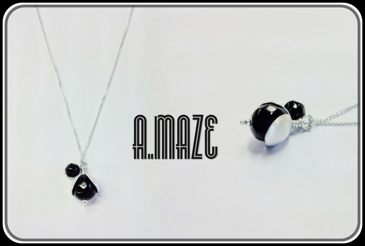 Black currant necklace with an onyx pendant.