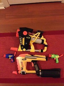 Two fully-automatic Nerf Guns w/2 pistols! missing two small guns - should be sent after xmas