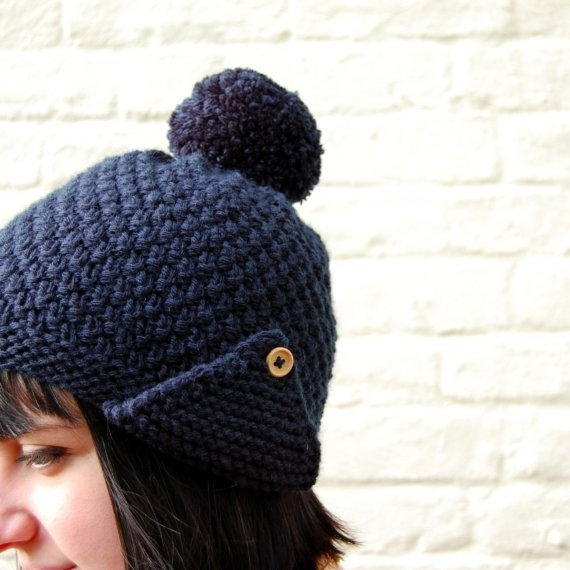 Knitted hat with pom pom.