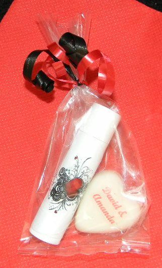 A personalized soap heart matched with a personalized lip balm.  This is an example of a cello bag with curl ribbons - but there are other packaging options available too.