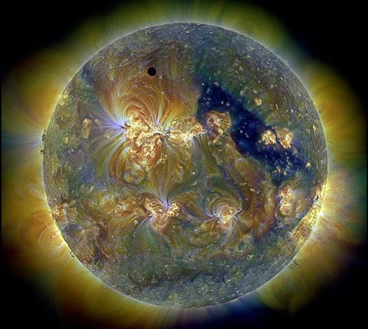 This image of our sun taken using ultra violet light.  The dark spot top left is Venus.